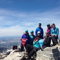 Summit for Someone climbers celebrate atop the Grand Teton. Photo courtesy of Big City Mountaineers.- 10 Summits You Should Climb in Your Life