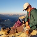 Reaching into a bag of gluten-free cookies on top of Florence Peak in Sequoia National Park.- The Best Gluten-Free Snacks for Backpacking