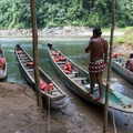 Young Embera men wait at the canoes as the group hiked to the waterfall.- 4-Day Adventure in and around Panama City, Panama