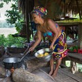 Embera woman cooking delicious tilapia from the Chagres River along with fried plantains.- 4-Day Adventure in and around Panama City, Panama
