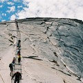 Climbing up the cables on Yosemite's Half Dome.- Summit Trips Along the Pacific Crest Trail