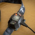 The LED indicator is red while the headlamp charges.- Gear Review: TEQIN Rechargeable Headlamp