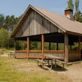 A picnic shelter on Coffenbury Lake's north shore.- Fort Stevens State Park Campground