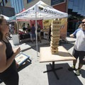 A game of Giant Jenga at the 2018 Outdoor Project Denver Block Party.- 2018 Outdoor Project Denver Block Party Recap