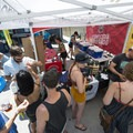 Locals perusing the Outdoor Project booth at the 2018 Outdoor Project Denver Block Party.- 2018 Outdoor Project Denver Block Party Recap