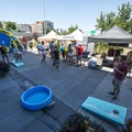 Corn hole and vendors at the 2018 Outdoor Project Denver Block Party.- 2018 Outdoor Project Denver Block Party Recap