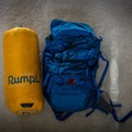 The Rumpl in it's stuff sack next to my normal daypack for reference. - Gear Review: Rumpl Original Puffy Blanket
