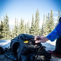 There are two side pockets. One is mesh with a layer of Cordura fabric down the middle for strength, and the other is full Cordura fabric. Both are sized to fit a tripod or even a pair of crampons without issue!- Gear Review: Mountainsmith Tanuck 40L Backpack