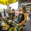 Party goers sign up for KEEN's raffle at the 2018 Outdoor Project Minneapolis Block Party.- 2018 Outdoor Project Minneapolis Block Party Recap