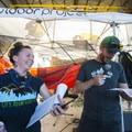 Agate, of Big City Mountaineers, and Kurt, of Gear Junkie, raffle off sweet outdoor prizes at the 2018 Outdoor Project Minneapolis Block Party.- 2018 Outdoor Project Minneapolis Block Party Recap