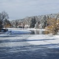 The icy Mirror Pond in Bend, Oregon. Drake Park.- Best U.S. Desert, Mountain, and Beach Towns