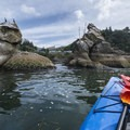 "Paddling up to the ""Three Graces"" within the Tillamook Bay channel.- The Tillamook Bay Heritage Route"