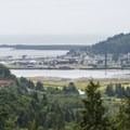 View of the town of Garibaldi with the iconic 1927-built Whitney Smokestack.- The Tillamook Bay Heritage Route