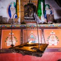 A candle lit in the Milarepa Cave monastery.- Nepal Undiscovered, Part 1: Tsum Valley Trek
