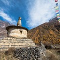 A Tibetan Buddhist stupa set in the middle of a vast valley.- Nepal Undiscovered, Part 1: Tsum Valley Trek