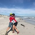 Jen Gurecki and professional skier Roz Groenewoud hug it out after cycling into Cape Town, South Africa on the final day of African Spokes.- Woman In The Wild: Jen Gurecki