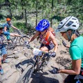 Lindsey coaches women through a tough lava rock section at their hometown camp in Bend, Oregon. Photo by Katie Sox.- Woman In The Wild: Lindsey Richter