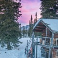Sunrise on the private Aneroid Lake cabins.- Backcountry Skiing in Oregon's Wallowa Mountains