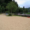 Volleyball court next to the marina.- Loon Lake Lodge + RV Resort