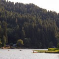 Kayakers enjoy an evening paddle on a warm summer's evening.- Loon Lake Lodge + RV Resort