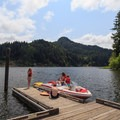 A family enjoys a day on the rented ski boat.- Loon Lake Lodge + RV Resort