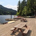 The substantial dock is ideal for picnicking.- Loon Lake Lodge + RV Resort