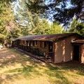 The motel is next to the lodge.- Loon Lake Lodge + RV Resort