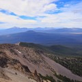 View of Crater Lake National Park on the horizon.- Mount Thielsen