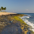 There are a couple of rocky sections of coastline.- Ma'ili Beach Park