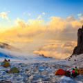 Warm evening light over the Winthrop Glacier as seen from Camp Schurman on Mount Rainier.- 10 Summits You Should Climb in Your Life