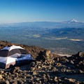 An ideal tent platform with a view of Mount Hood to the south on the Lunch Counter.- Mount Adams: South Climb