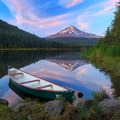 A vibrant sunset over still waters at the end of an adventurous day canoeing on Trillium Lake.- Trillium Lake