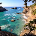 Kayakers paddle north of the point toward Secret Beach.- Thunder Rock Cove