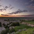 A vibrant sunrise over the plains near Badlands National Park.- Badlands National Park