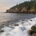 Gentle waves break on the rocky beach below Otter Cliffs.- 3-Day Itinerary in Acadia National Park