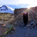 The sun peaks out from behind the Cooper Spur Shelter.- Mount Hood's 15 Best Day Hikes