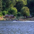 Wake boarder on Loon Lake.- Loon Lake: The Oregon Coast's Hidden Summer Destination