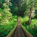 Long footbridge over Cape Creek.- Cape Lookout State Park