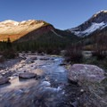 Sunrise over South Mineral Creek with alpenglow on the surrounding peaks.- South Mineral Campground