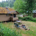 Deluxe cottage backyard.- Loon Lake Lodge + RV Resort