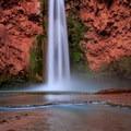 Havasu Creek pours over Mooney Falls just below the Havasu Campground.- Havasu Falls Hike via Havasupai Trail