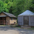Yurt Y01 sleeps two and is next to Basic Cottage 9.- Loon Lake Lodge + RV Resort