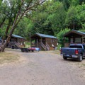 Deluxe Cabins parking area.- Loon Lake Lodge + RV Resort