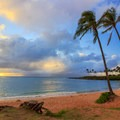Beach palms leaning over a beautiful sunset at Kapalua Bay.- Best Beaches in Maui