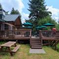 The Loon Lake Lodge back deck.- Loon Lake Lodge + RV Resort