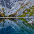 Incredible colors of Colchuck Lake and its shore.- Enchantment Lakes Hike via Colchuck Lake