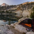 Lakeside Campsite as the Sun Rises Over Eagle Cap and Mirror Lake- Oregon's 60 Best Lakes for Summer