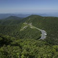 View from the Craggy Gardens Pinnacle summit, looking over the visitor center.- 15 Must-Do Adventures Along The Blue Ridge Parkway