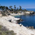 La Jolla Cove with Scripps Park in the background.- Adventurer's Guide to San Diego