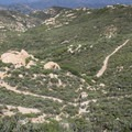 Nearing the summit of Iron Mountain and looking down over switchbacks.- 10 Must-Do Hikes in San Diego